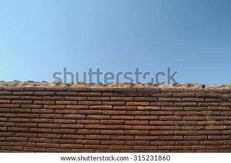 Brick wall and sky - stock photo
