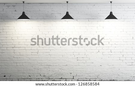 brick wall and three ceiling lamp - stock photo