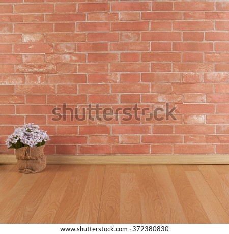 Brick wall and wooden floor texture with flower  - stock photo
