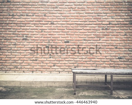 Brick wall background textured and pattern with old chair,vintage style.