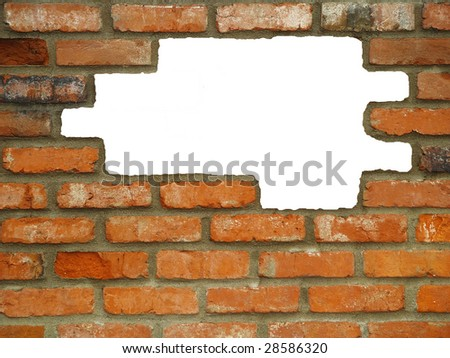 Brick wall background, with large white holes, in various shades of red, orange, brown, tan, and white. - stock photo