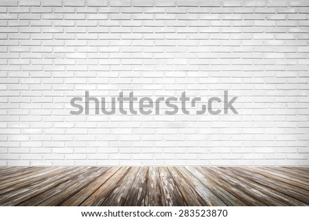 Brick wall background with wood floor - stock photo