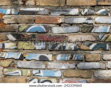 Brick wall colorful graffiti - stock photo