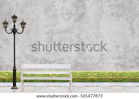 Brick Wall Concept : Electric Light Lamp Post And White Chair At Green Bush  Fence On