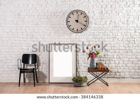 brick wall frame and black chair office wall decor - stock photo