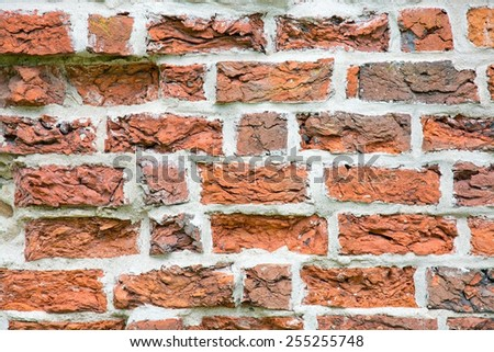 Brick wall from medieval 13th century brick ruin, Ahus, South Sweden. - stock photo