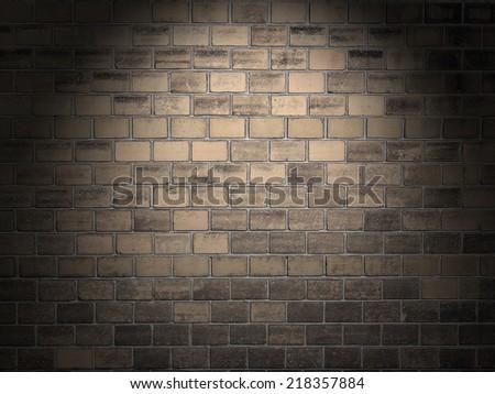 Brick wall illuminated with a spotlight - stock photo