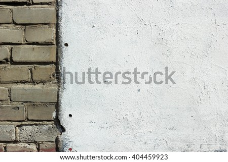 Brick wall in half with plastered wall