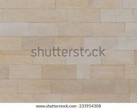brick wall made �¢??�¢??of light beige natural travertine  - stock photo
