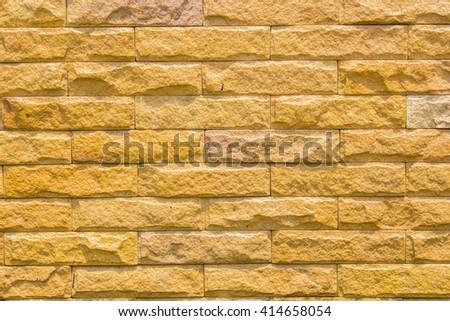 brick wall made of light brown facing bricks, seamless texture background - stock photo