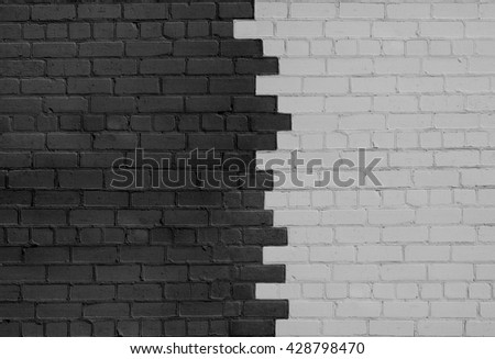 Brick Wall Parted on Dark and Light Sides in the Middle - stock photo