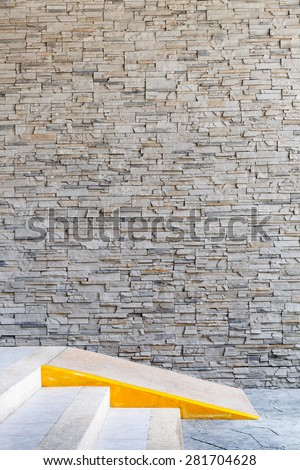 Brick wall pattern of exterior building and ramp access for disabled facility. - stock photo