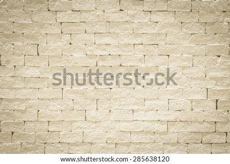 Brick wall pattern texture background painted in light antique yellow cream color tone: Empty masonry wall textured backdrop in yellow beige colour  - stock photo