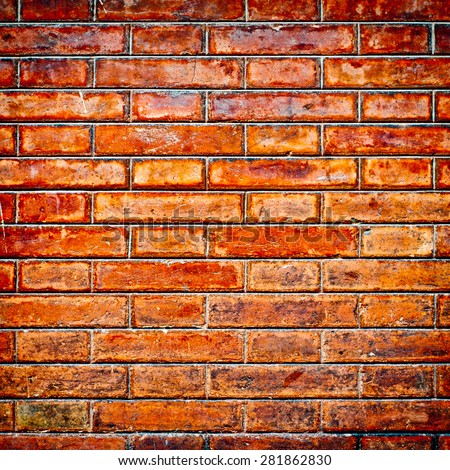 Brick wall texture background. Weathered brown stone facade. - stock photo