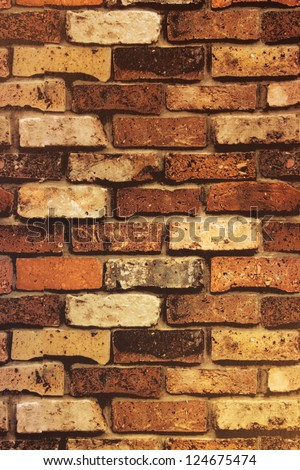 Brick Wall Texture/Brick wall with some bricks lighter colored. Texture and background vertical - stock photo