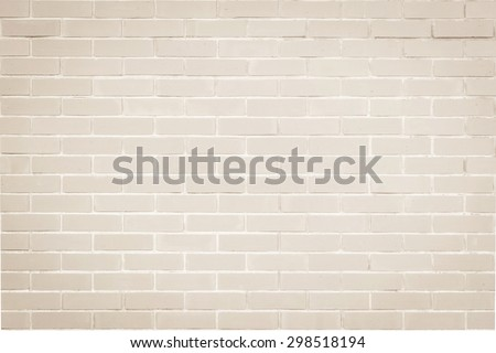 Brick wall texture pattern background in natural light ancient cream beige brown color tone: Masonry brick work wall detail textured backdrop with vignette   - stock photo