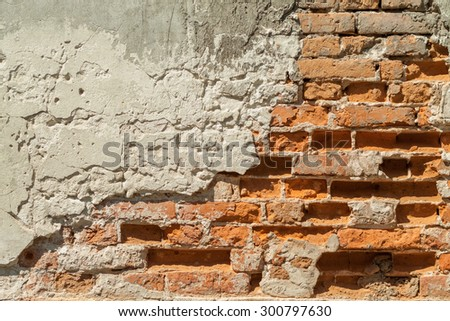 Brick wall. Vintage street brick background. Weathered texture of stainted old brik wall. Grunge rusty blocks. Urban wallpaper. Nature artistic texture.