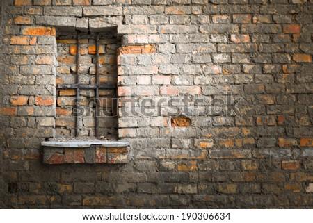 brick wall, windows in jail - stock photo