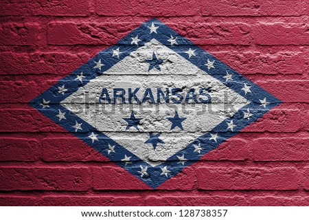 Brick wall with a painting of a flag isolated, Arkansas