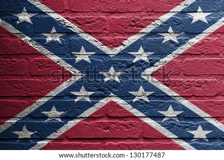 Brick wall with a painting of a flag isolated, confederate flag