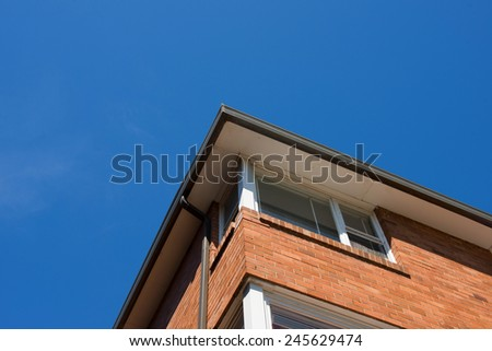 Brick wall with blue sky
