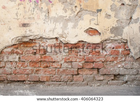 brick wall with crumbling plaster