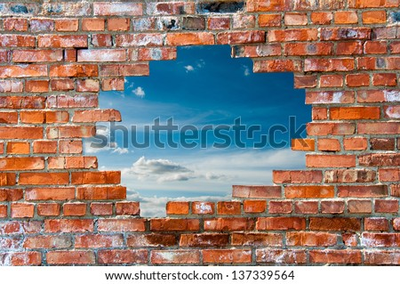 brick wall with hole - stock photo