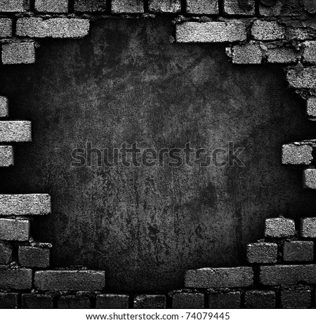 brick wall with large hole - stock photo