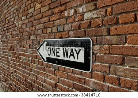 Brick Wall With One-Way Sign - stock photo