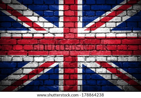 Brick wall with painted flag of Great Britain - stock photo