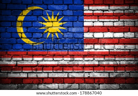 Brick wall with painted flag of Malaysia - stock photo