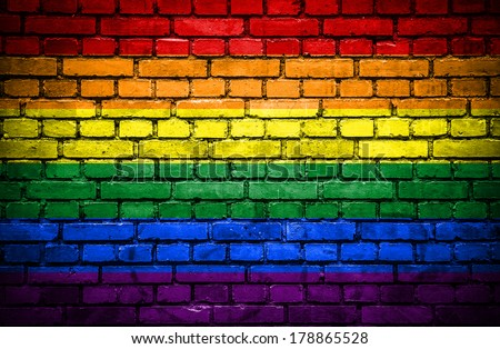 Brick wall with painted flag of Pride - stock photo