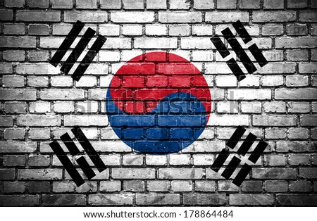 Brick wall with painted flag of South Korea - stock photo