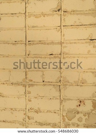 Brick wall with peeling paint. Abstract texture.