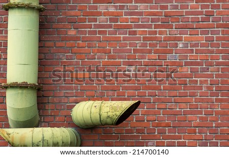 brick wall with pipes background - stock photo