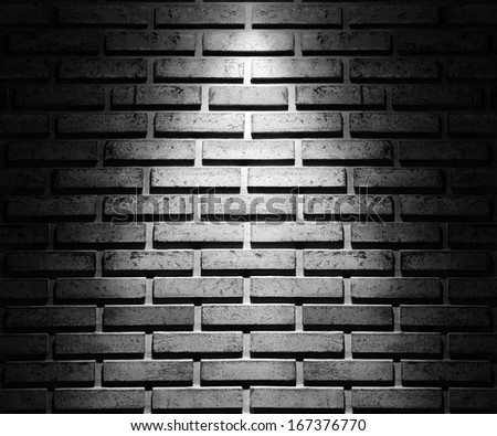 brick wall with spot light - stock photo
