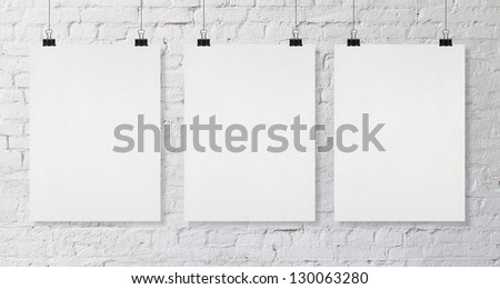 brick wall with three blank poster - stock photo
