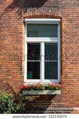 Brick wall with windows - stock photo