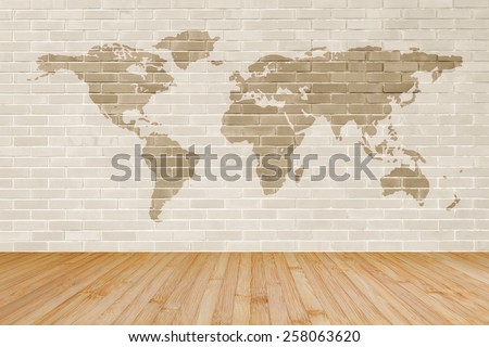 Brick wall with world map and wooden floor background  - stock photo