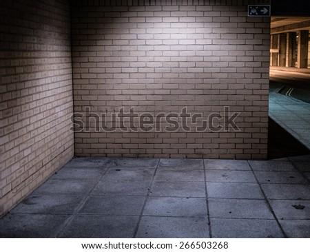 Brick Walls of Deserted Street Alcove Corner Illuminated at Night - stock photo