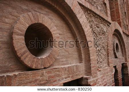 Brick walls with circles.  Shot at Montserrat in Spain. - stock photo