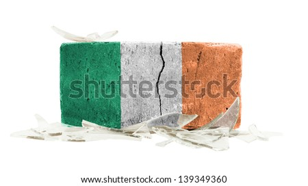 Brick with broken glass, violence concept, flag of Ireland