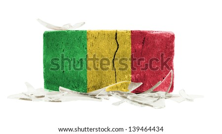 Brick with broken glass, violence concept, flag of Mali