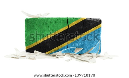 Brick with broken glass, violence concept, flag of Tanzania