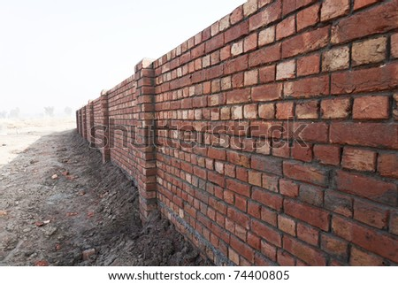 bricked wall exposed in the day light. - stock photo