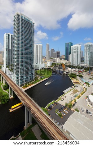 BRICKELL - AUGUST 26: Aerial vertical image of Brickell and the Miami River August 26, 2014 in Brickell USA. The Miami River stems from the Everglades and runs through Downtown Miami.  - stock photo