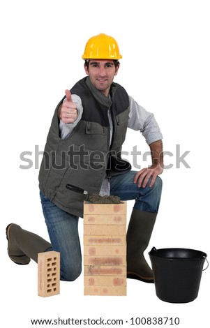 Bricklayer giving his sign of approval - stock photo