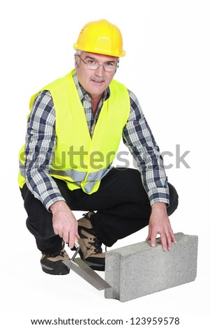 Bricklayer in a reflective vest - stock photo