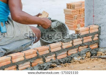 Bricklayer in site - stock photo