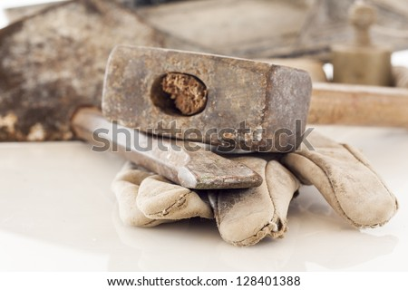 bricklayer tools (chisel and hammer) ,construction background - stock photo